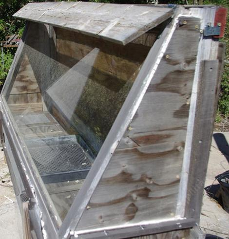 A fruit or vegetable dryer.Top lid was meant to close top on rain. Really wasn't needed. - grid24_12