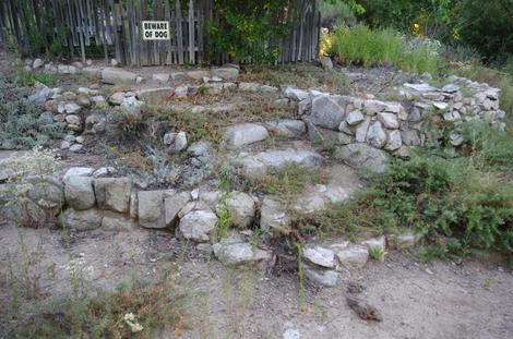 No it;s not a pile of rocks. It's a dry California garden with two rock walls and some steps.  - grid24_12