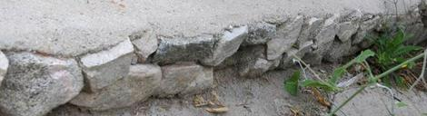 If you want plan on building a patio or such you can use the edges of the pad as a retaining wall. Put some rocks against the form before you pour the cement. When you pop the form, was the cement off of the rocks. - grid24_12