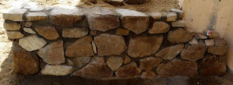 The corner of the rock wall ran into a faucet. You could extend the faucet or make the wall shorter. - grid24_12