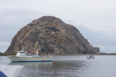 A Boat coming into the harbor at Morro Bay - grid24_12