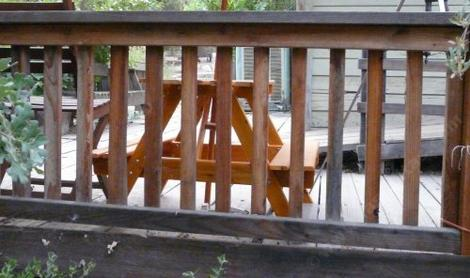 Deck rail or fence made out of 2x2 redwood with a 2x6 cap. - grid24_12