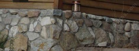a concrete foundation covered with rock - grid24_12