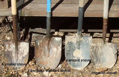 Some of the different shovels that have been used for planting our native plants. - grid24_12